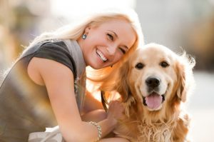 happy-woman-with-her-dog_p4nqj6